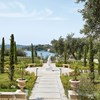 Corfu Imperial richness of velvet green trees that plunge into the bluest of waters