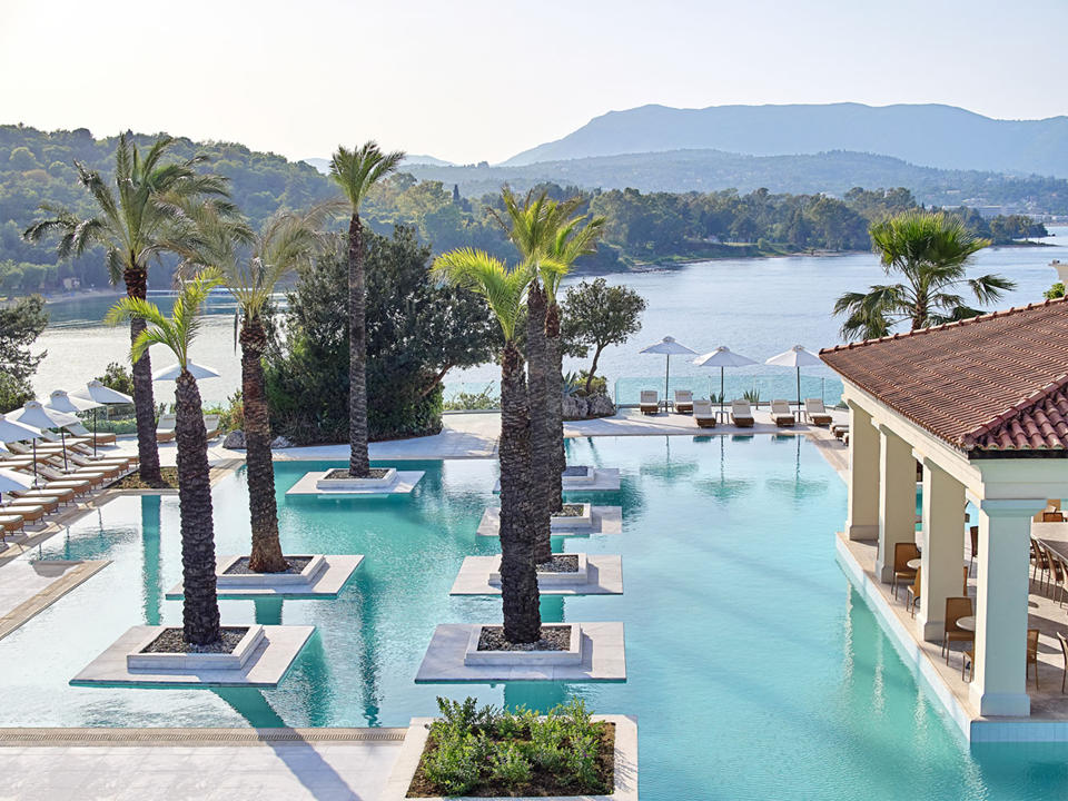Impressive pool complex dotted with palm trees)