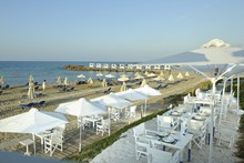 Узери. Knossos Beach Bungalows & Suites